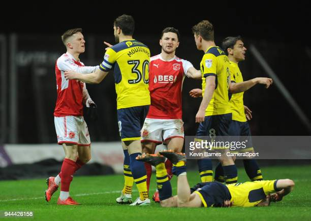 Tempers flare between Fleetwood Town's Ashley Hunter and Oxford United's John Mousinho after a foul on Cameron Brannagan during the Sky Bet League...