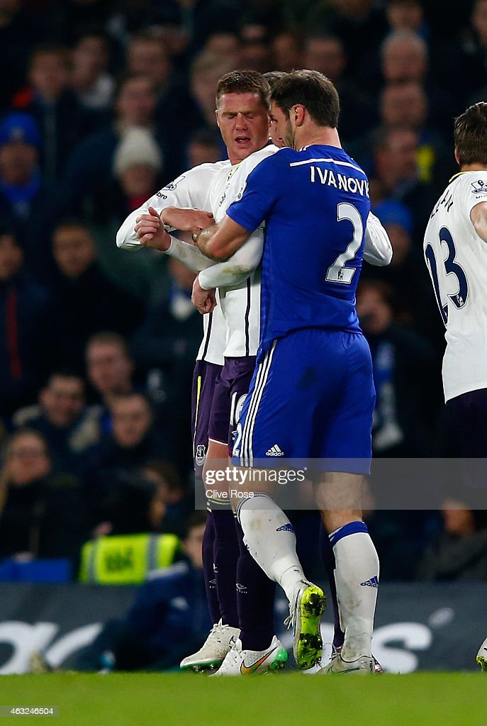 Tempers flare between James McCarthy of Everton and Branislav Ivanovic of Chelsea during the Barclays Premier League match between Chelsea and Everton at Stamford Bridge on February 11, 2015 in London, England