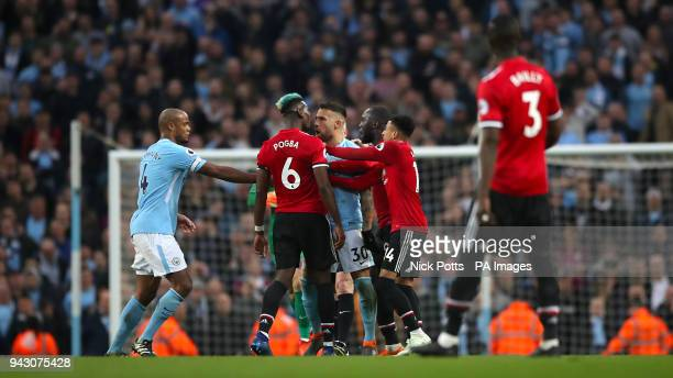 Tempers flare between Manchester United's Paul Pogba and Manchester City's Nicolas Otamendi during the Premier League match at the Etihad Stadium...