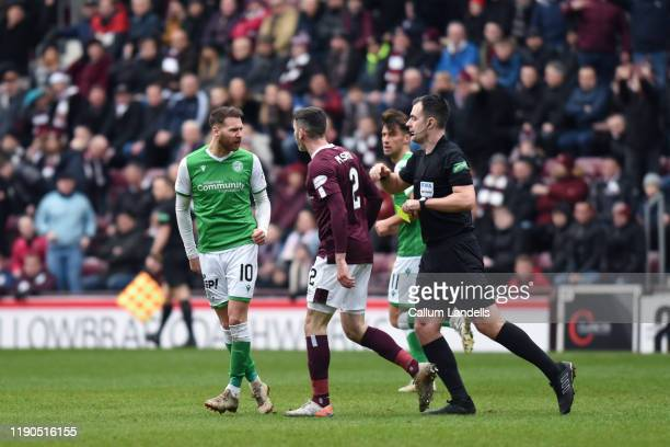 Tempers flare between Martin Boyle of Hibernian FC and Michael Smith of Heart of Midlothian FC during the Ladbrokes Premiership match between Hearts...