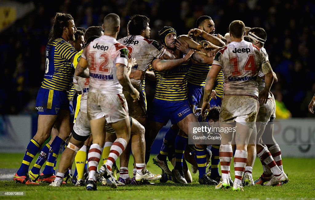 Tempers flare between rival players during the World Club Series match between Warrington Wolves and St George Illawarra Dragons at The Halliwell Jones Stadium on February 20, 2015 in Warrington, England.