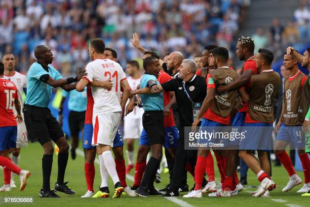 Tempers flare between Serbia and Costa Rica players as fourth official tries to step in after Nemanja Matic of Serbia clashes with Celso Borges of...