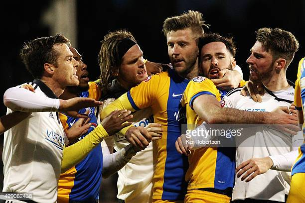Tempers flare between the teams after Tom Clarke of Preston North End and James Husband of Fulham tussle on the ground during the Sky Bet...