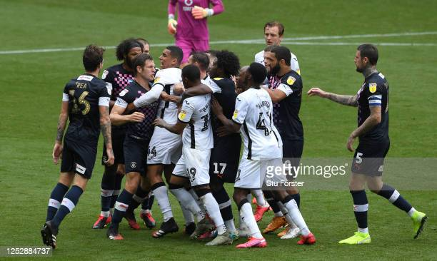 Tempers flare between the teams during the Sky Bet Championship match between Swansea City and Luton Town at Liberty Stadium on June 27 2020 in...