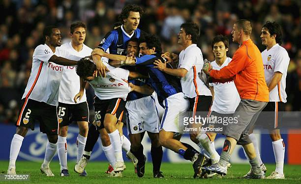 Tempers flare between Viana Hugo of Valencia and Nicolas Burdisso and Ivan Cordoba of Inter Milan at the final whistle of the UEFA Champions League...