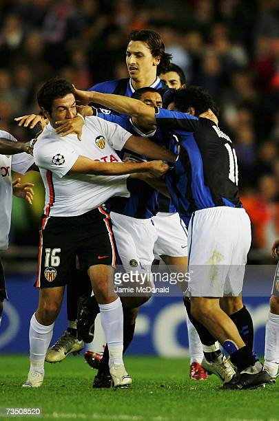 Tempers flare between Viana Hugo of Valencia and Nicolas Burdisso of Inter Milan at the final whistle of the UEFA Champions League round of sixteen...