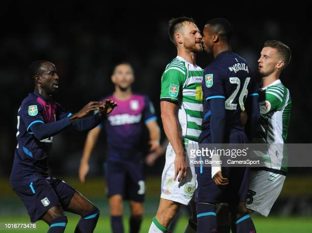 Tempers flare between Yeovil Town's Gary Warren and Aston Villa's Jonathan Kodjia during the Sky Bet League Two match between Yevoil Town and...