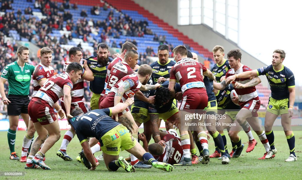Tempers flare during the game between Wigan Warriors and Wakefield Trinity, during the Betfred Super League match at the DW Stadium, Wigan.