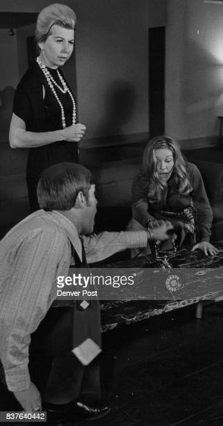 Tempers flare in a tense moment from the Bonfils Theatre production of the comedy Any Wednesday Bill Brady Ora Keller and Glenna Newcomb from left...