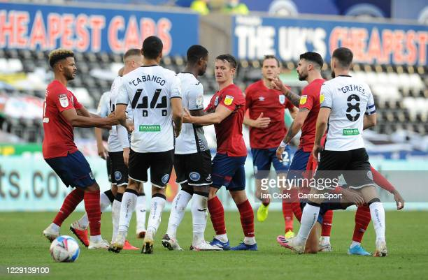Tempers flare towards the end of the game during the Sky Bet Championship match between Swansea City and Huddersfield Town at Liberty Stadium on...