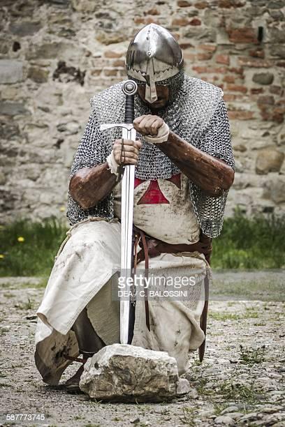 Templar knight kneeling in prayer 13th14th century Historical reenactment