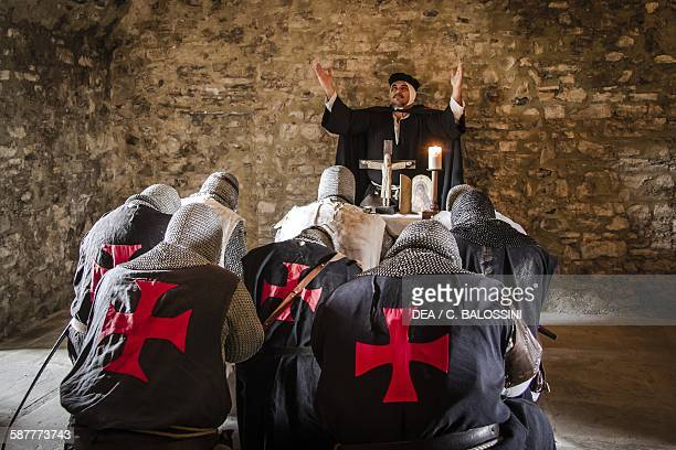Templar knights praying with a priest before leaving for the crusades 13th century Historical reenactment