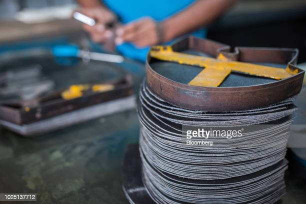 A template sits on a pile of cut leather patterns for safety shoes on a desk at the Lyra Ltd factory in Karachi Pakistan on Thursday Aug 16 2018 Lyra...
