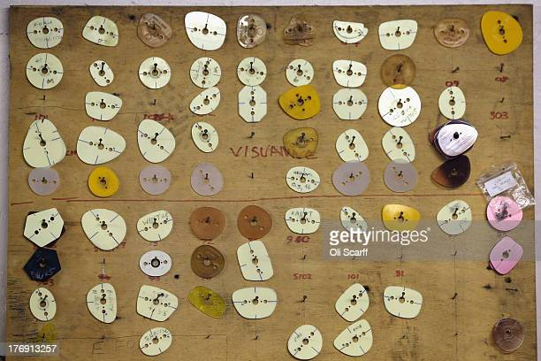 bab7543ba9c Templates for the frame shape of spectacles are displayed in the Savile Row  glasses factory in