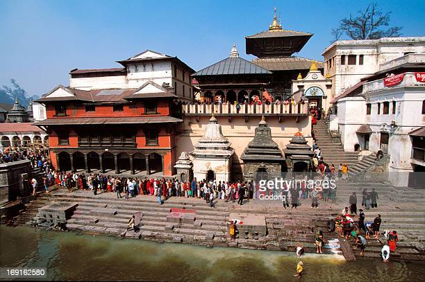 Temple and devotees on the Bagmati river bank in Pashupatinath holy city