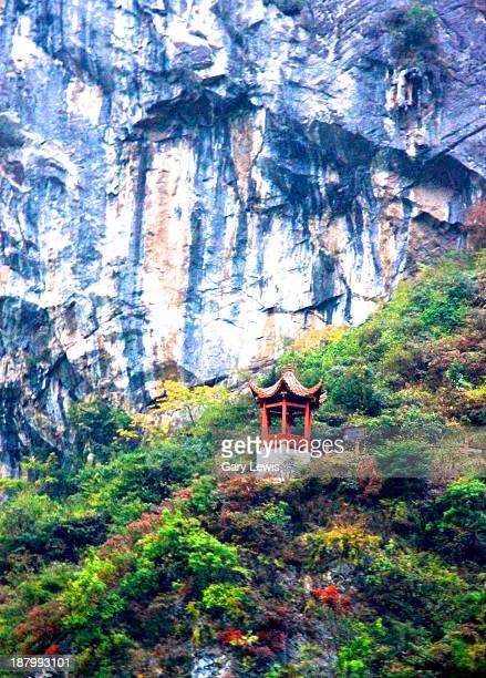 Temple clings to the side of a mountain in the Wu Gorge, on the Daning River a tributary of the Yangtze River.