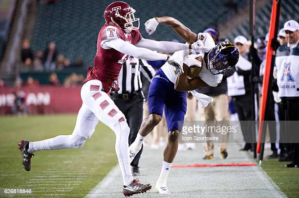 Temple DB Derrek Thomas pushes East Carolina WR Zay Jones out on a reception in the first half during the game between the East Carolina Pirates and...