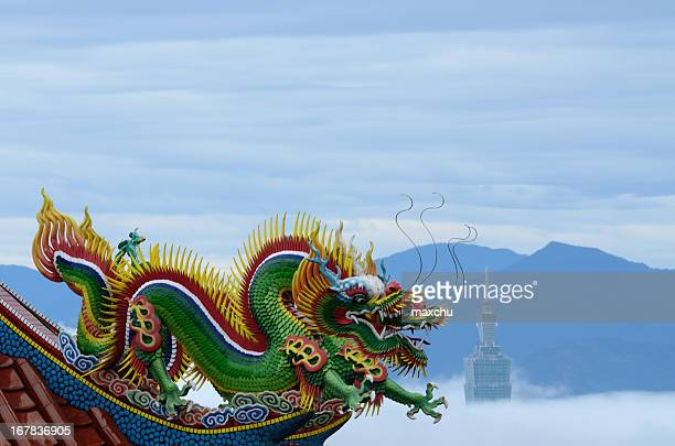 temple dragon statue with taipei 101 - chinese dragon stock photos and pictures