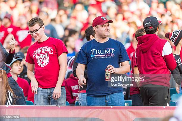 Temple fan holds his Yuengling Lager while he wears his 'Trump for President' tshirt during the game between the Cincinnati Bearcats and the Temple...