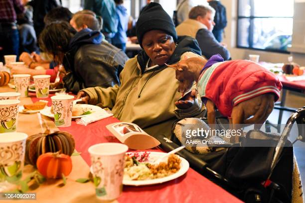 Temple Gaston feeds her dog Bou from her hand during a Thanksgiving meal at the Denver Rescue Mission on Wednesday November 21 2018 Some 600 people...
