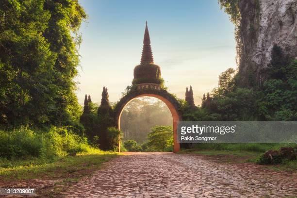 temple gate at khao na nai luang dharma park in the morning - grand palace - bangkok stock pictures, royalty-free photos & images