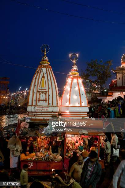 temple in ganga river decorated with lights, haridwar, uttarakhand, india, asia - haridwar stock pictures, royalty-free photos & images