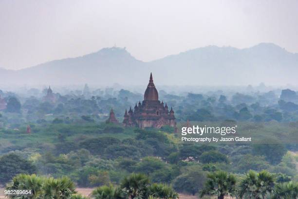 temple in the mist early morning in bagan, myanmar - myanmar stock pictures, royalty-free photos & images