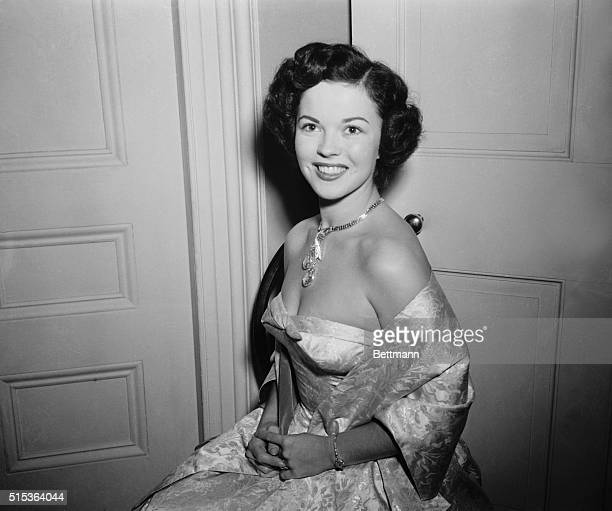 Temple Jewels Washington Mrs Charles A Black better known to film fans as Shirley Temple models an Indian pearshaped diamond valued at $750 which is...