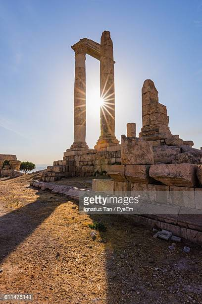 temple of hercules against clear blue sky - amman stock pictures, royalty-free photos & images