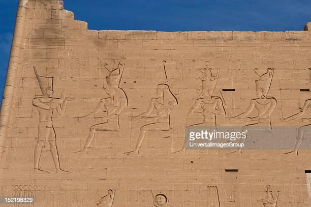Temple of Horus, Pharaoh before gods, Main entrance, First pylon, Detail, Edfu, Egypt.
