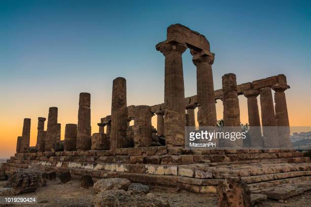 temple of juno at sunset in the valley of the temples - archaeology stock pictures, royalty-free photos & images