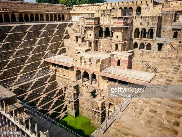 temple of many steps india - abhaneri stock photos and pictures