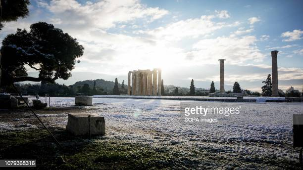 Temple of Olympian Zeus covered with snow in the early hours on Tuesday A snow storm ''Tilemachos'' sweeps over Athens is keeping the mercury far...