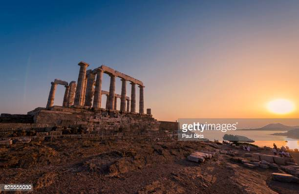 temple of poseidon at sunset in sounio cape in attica region, greece - ギリシャ文化 ストックフォトと画像