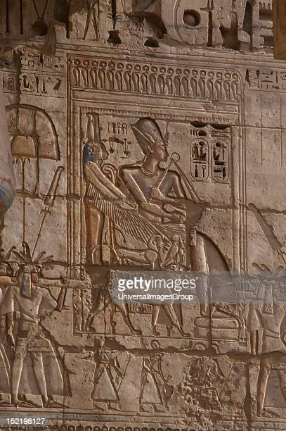 Temple of Ramses III Ramses III wearing Khepresh being carried in procession Relief New Kingdom Twentieth dynasty Thebes MedinetHabou Egypt