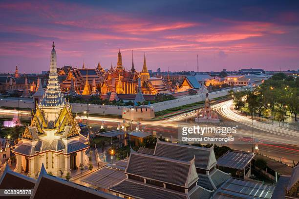 Temple of the Emerald Buddha (Wat Phra Kaew) on the grounds of the Grand Palace at twilight time in Bangkok, Thailand