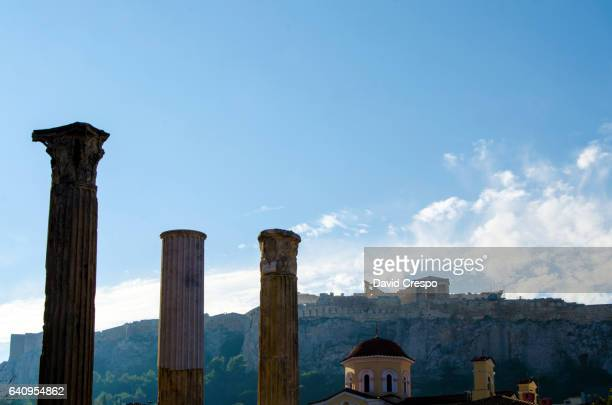 temple of the olympian zeus and the acropolis in athens, greece - bailout stock pictures, royalty-free photos & images