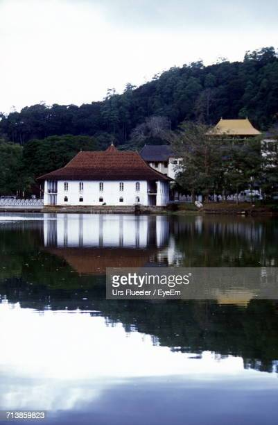 temple of the tooth by kandy lake - dalada maligawa stock photos and pictures