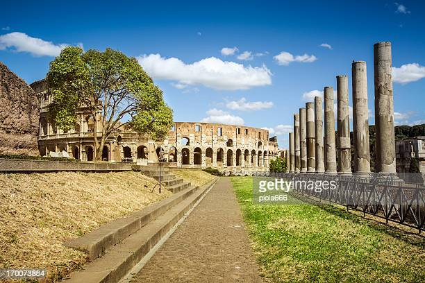 temple of venus and roma by the coliseum - coliseum rome stock photos and pictures
