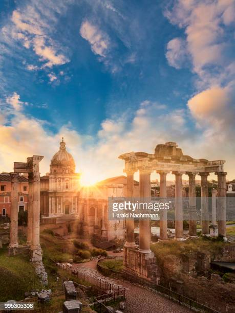 temple of vespasian and titus and church of santi luca e martina at forum romanum at sunrise, rome, lazio, italy - old ruin stock pictures, royalty-free photos & images