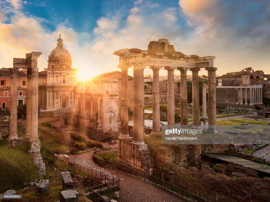 Temple of Vespasian and Titus and Church of Santi Luca e Martina at Forum Romanum at sunrise, Rome, Lazio, Italy : Stock Photo