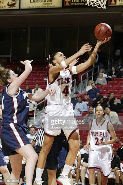 Temple Owls Candice Dupree had 12 rebounds and 9 points during a 63 to 46 Temple Owl victory over the Penn Quakers at the Liacouras Ctr in...