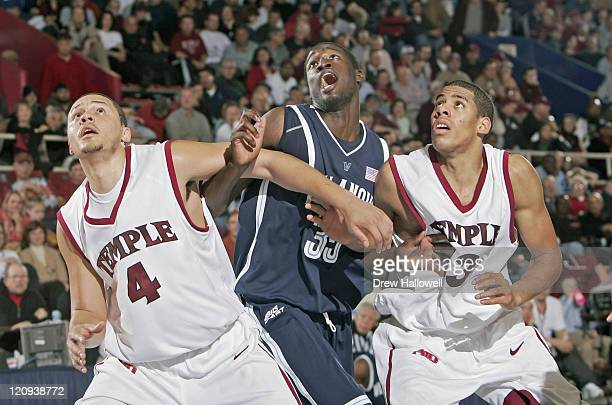 Temple Owls Dion Dacons and Mark Tyndale defende against Villanova's Shane Clark Saturday December 31 2005 at The Palestra in Philadelphia PA...