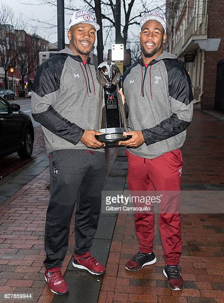 Temple Owls Football Team linebackers Avery Ellis and Haason Reddick pose with The American Athletic Conference Trophy during a visit to Fox 29's...