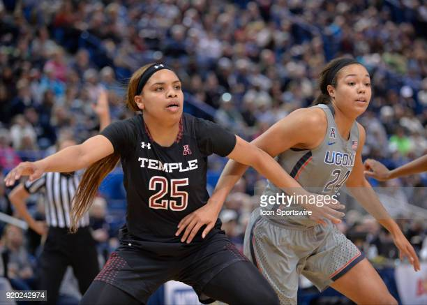 Temple Owls Forward Mia Davis and UConn Huskies Forward Napheesa Collier battle for the rebound during the game as the UConn Huskies host the Temple...