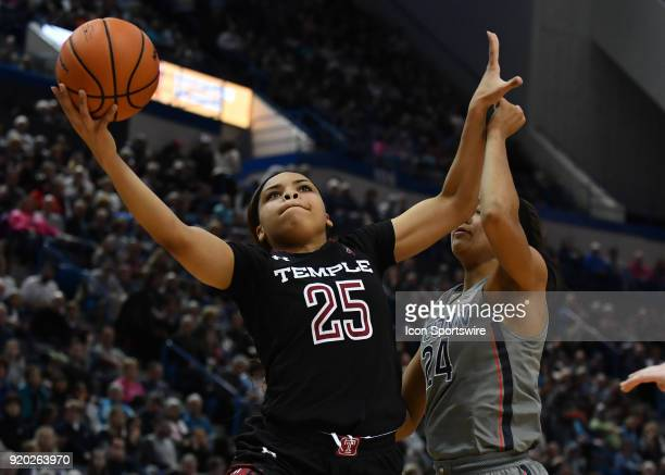 Temple Owls Forward Mia Davis gets by UConn Huskies Forward Napheesa Collier and scores during the game as the UConn Huskies host the Temple Owls on...