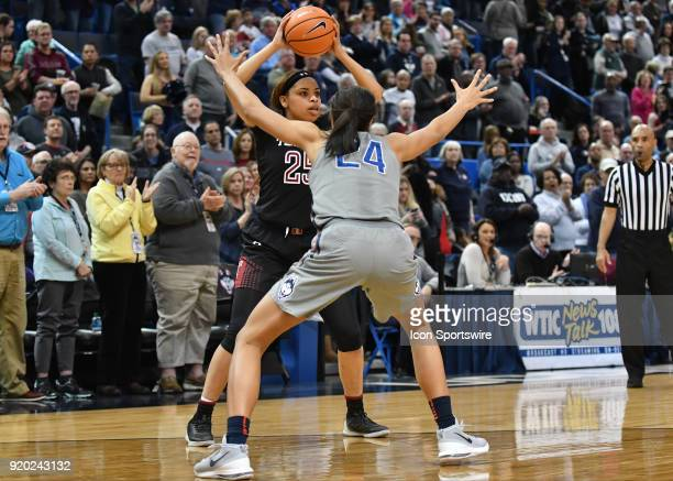 Temple Owls Forward Mia Davis looks to pass as UConn Huskies Forward Napheesa Collier defends during the game as the UConn Huskies host the Temple...