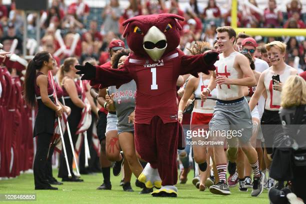 Temple Owls mascot Hooter leads the team onto the field during a college football game between the Villanova Wildcats and the Temple Owls on...