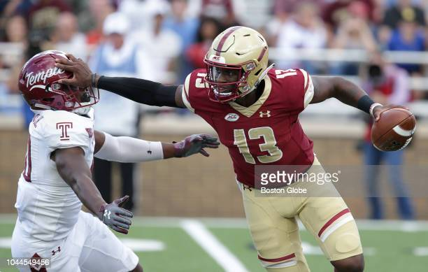 Temple Owls' Todd Jones gets stiffarmed by Boston College quarterback Anthony Brown Boston College hosts Temple University in a college football game...