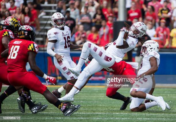 Temple Owls wide receiver Isaiah Wright pulled down by Maryland Terrapins defensive back Darnell Savage Jr during a college football game between the...